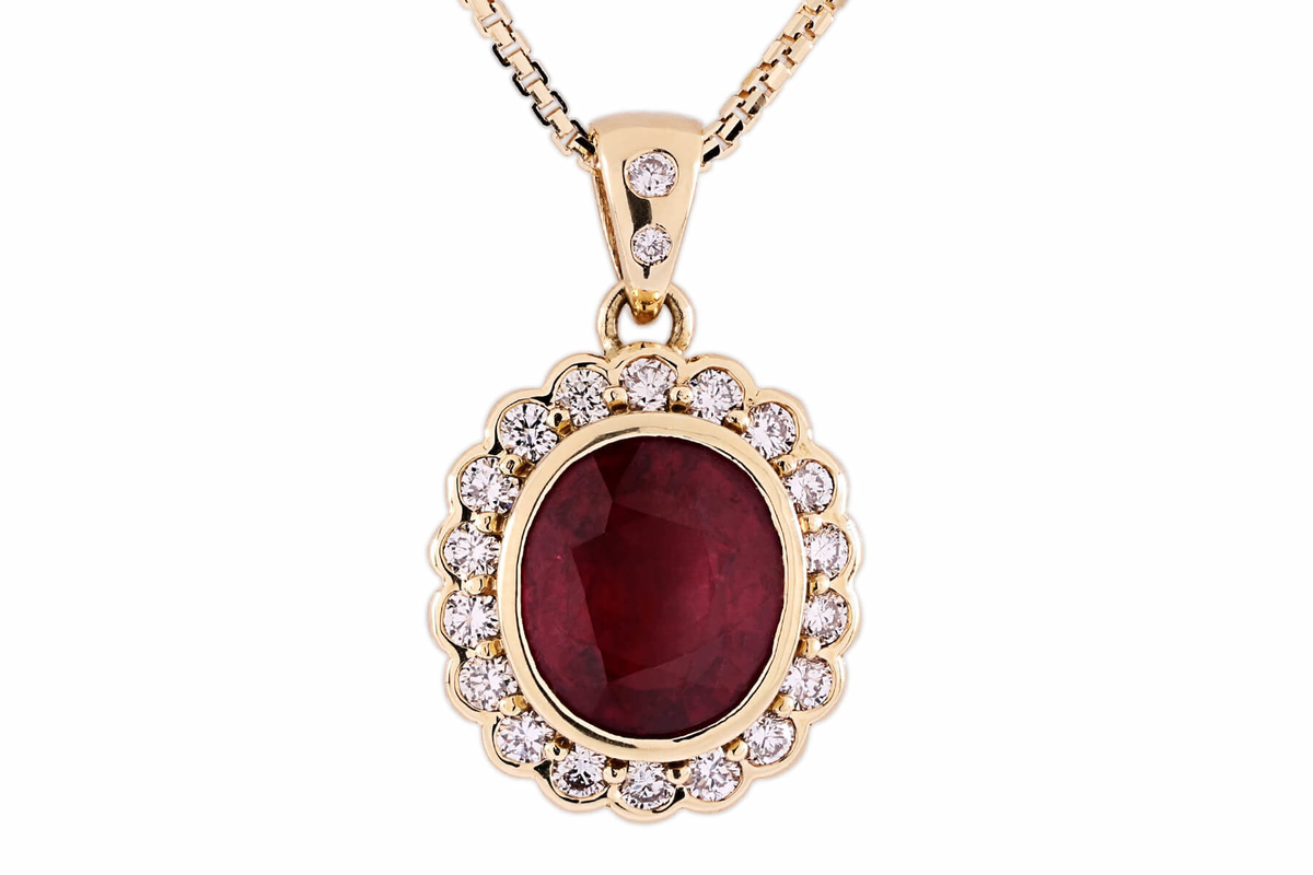 tok_jewellers_roseanne_18k_yellow_gold_oval_ruby_and_diamond_halo_pendant.jpg